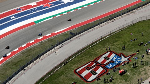 <p>               Fans sit near a tribute to Nicky Hayden as they watch a practice session for the Grand Prix of the Americas motorcycle race at the Circuit Of The Americas, Friday, April 12, 2019, in Austin, Texas. MotoGP has retired Hayden's No. 69. (AP Photo/Eric Gay)             </p>