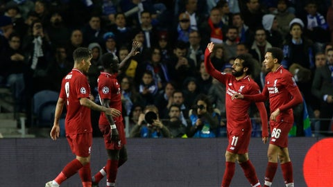 <p>               Liverpool's Mohamed Salah, second right, celebrates after scoring his side's second goal during the Champions League quarterfinal, 2nd leg, soccer match between FC Porto and Liverpool at the Dragao stadium in Porto, Portugal, Wednesday, April 17, 2019. (AP Photo/Armando Franca)             </p>