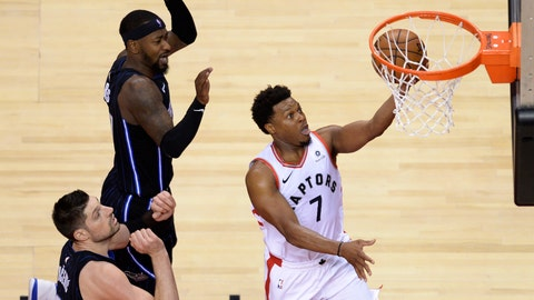 <p>               Toronto Raptors guard Kyle Lowry (7) scores past Orlando Magic center Nikola Vucevic (9) and guard Terrence Ross (31) during the second half of Game 2 of an NBA basketball first-round playoff series Tuesday, April 16, 2019, in Toronto. (Nathan Denette/The Canadian Press via AP)             </p>