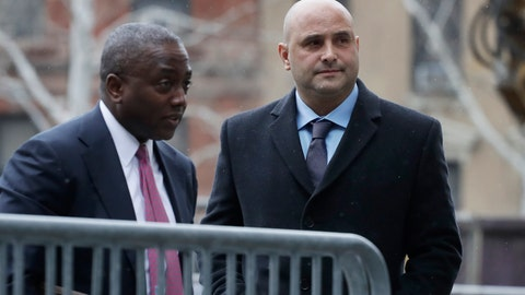 <p>               Craig Carton, right, the former co-host of a sports radio show with ex-NFL quarterback Boomer Esiason, arrives at federal court to be sentenced for defrauding investors in a ticket reselling business, Friday, April 5, 2019, in New York. (AP Photo/Mark Lennihan)             </p>