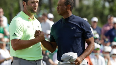 <p>               Tiger Woods shakes hands with Jon Rahm, of Spain, after their first round for the Masters golf tournament Thursday, April 11, 2019, in Augusta, Ga. (AP Photo/Marcio Jose Sanchez)             </p>