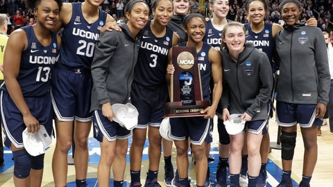 <p>               Connecticut players pose for photos with the trophy after defeating Louisville in a regional championship final in the NCAA women's college basketball tournament, Sunday, March 31, 2019, in Albany, N.Y. (AP Photo/Kathy Willens)             </p>