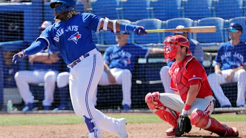 <p>               FILE - In this Feb. 28, 2019, file photo, Toronto Blue Jays' Vladimir Guerrero Jr., left, follows through with a double as Philadelphia Phillies catcher Andrew Knapp looks on in the third inning of a spring training baseball game in Dunedin, Fla. The Toronto Blue Jays will promote top prospect Vladimir Guerrero Jr. before their game against the Oakland Athletics, on Friday, April 26. (AP Photo/Lynne Sladky, File)             </p>