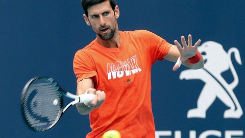 <p>               FILE - In this March 18, 2019, file photo, Novak Djokovic hits during a practice round for the Miami Open tennis tournament at Hard Rock Stadium in Miami Gardens, Fla. As Djokovic begins his preparations for a fourth straight Grand Slam title, he likes to imagine beating Rafael Nadal in the French Open final. (Charles Trainor Jr./Miami Herald via AP, File)             </p>