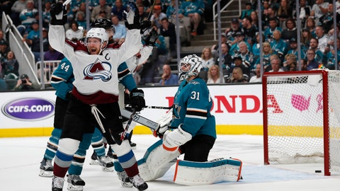 <p>               Colorado Avalanche's Gabriel Landeskog (92) celebrates a goal against San Jose Sharks goaltender Martin Jones (31) by teammate Tyson Barrie (not shown) in the second period of Game 2 of an NHL hockey second-round playoff series at the SAP Center in San Jose, Calif., on Sunday, April 28, 2019. (AP Photo/Josie Lepe)             </p>