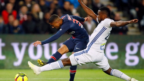 <p>               PSG's Colin Dagba, left, fights for the ball with Strasbourg's Lionel Carole during the French League One soccer match between Paris-Saint-Germain and Strasbourg at the Parc des Princes stadium in Paris, France, Sunday, April 7, 2019. (AP Photo/Francois Mori)             </p>