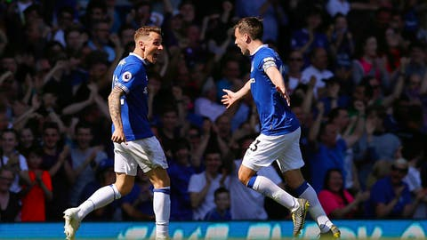 <p>               Everton's Lucas Digne, left, celebrates scoring against Manchester United with teammate Seamus Coleman during the English Premier League soccer match at Goodison Park, Liverpool, England, Sunday April 21, 2019. (Martin Rickett/PA via AP)             </p>