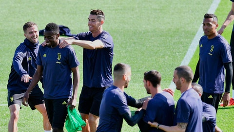<p>               Juventus forward Cristiano Ronaldo, 3rd from left, jokes with teammate Blaise Matuidi and Miralem Pjanic, left, during a training session ahead f Tuesday's Champions League, quarter final second leg soccer match between Juventus and Ajax, at the Juventus sport center, near Turin, Italy, Monday, April 15, 2019. (Alessandro Di Marco/ANSA via AP)             </p>