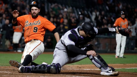 <p>               San Francisco Giants' Brandon Belt, left, slides to score behind Colorado Rockies' Chris Iannetta in the 18th inning of a baseball game Saturday, April 13, 2019, in San Francisco. (AP Photo/Ben Margot)             </p>