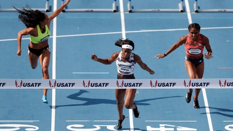 <p>               FILE - In this June 23, 2018, file photo, Keni Harrison, center, crosses the finish line ahead of Queen Harrison, left, and Christina Manning, right, to win the women's 100-meter hurdles final at the U.S. Championships athletics meet, in Des Moines, Iowa. Harrison will try to become just the second four-time meet champion in the 100-meter hurdles at this weekend's Drake Relays. (AP Photo/Charlie Neibergall, File)             </p>