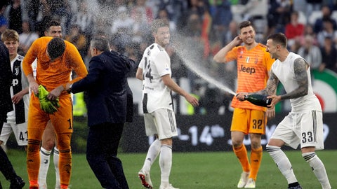 <p>               Juventus players celebrate at the end of a Serie A soccer match between Juventus and AC Fiorentina, at the Allianz stadium in Turin, Italy, Saturday, April 20, 2019. Juventus clinched a record-extending eighth successive Serie A title, with five matches to spare, after it defeated Fiorentina 2-1. (AP Photo/Luca Bruno)             </p>