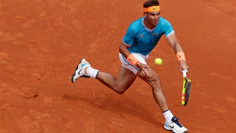 <p>               Rafael Nadal of Spain returns the ball to David Ferrer of Spain during his men's singles match at the Barcelona Open Tennis Tournament in Barcelona, Spain, Thursday, April 25, 2019. (AP Photo/Manu Fernandez)             </p>