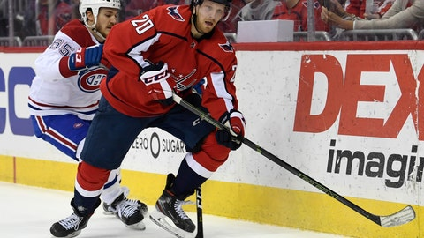<p>               Washington Capitals Lars Eller (20), or Denmark, carries the puck under pressure from Montreal Canadiens Andrew Shaw (65) during the second period of their NHL hockey game in Washington, Thursday, April 4, 2019. (AP Photo/Susan Walsh)             </p>