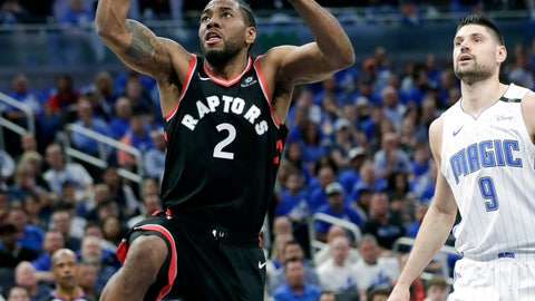 <p>               Toronto Raptors' Kawhi Leonard (2) gets a shot off as he gets past Orlando Magic's Nikola Vucevic (9) during the first half in Game 4 of a first-round NBA basketball playoff series, Sunday, April 21, 2019, in Orlando, Fla. (AP Photo/John Raoux)             </p>