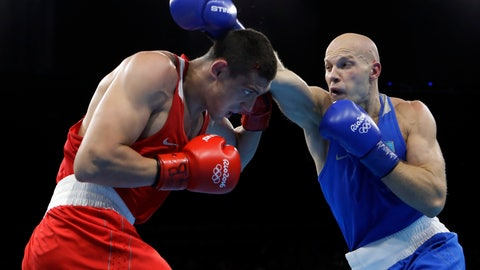 <p>               FILE - In this Monday, Aug. 15, 2016 file photo, Kazakhstan's Vassiliy Levit, right, fights Russia's Evgeny Tishchenko during a men's heavyweight 91-kg final boxing match at the 2016 Summer Olympics in Rio de Janeiro, Brazil. The International Boxing Association has as few as six weeks left to save the sport's place at the 2020 Olympics. Now its new interim president has arrived in the IOC's home city Lausanne for the final rounds of lobbying. Mohamed Moustahsane is a long-time ringside doctor from Morocco, who praised his predecessor whose alleged links to organized crime helped provoke the crisis in Olympic boxing. (AP Photo/Frank Franklin II, FIle)             </p>