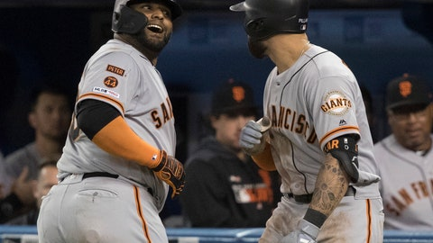 <p>               San Francisco Giants Pablo Sandoval greeted by teammate Kevin Pillar after he hit a solo home run against the Toronto Blue Jays  during the eighth inning of a baseball game, Tuesday, April 23, 2019 in Toronto. (Fred Thornhill/Canadian Press via AP)             </p>