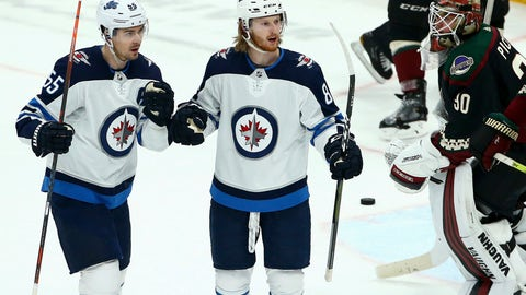 <p>               Winnipeg Jets left wing Kyle Connor, middle, celebrates his goal against Arizona Coyotes goaltender Calvin Pickard (30) as Jets center Mark Scheifele (55) joins Connor during the second period of an NHL hockey game Saturday, April 6, 2019, in Glendale, Ariz. (AP Photo/Ross D. Franklin)             </p>