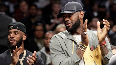 <p>               Chris Paul and LeBron James applaud during a ceremony at an NBA basketball game between the Brooklyn Nets and the Miami Heat, Wednesday, April 10, 2019, in New York. The pair were there to watch Heat guard Dwyane Wade play his last NBA game. (AP Photo/Kathy Willens)             </p>
