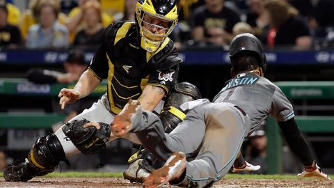 <p>               Pittsburgh Pirates catcher Francisco Cervelli, left, can't get the tag on Arizona Diamondbacks' Jarrod Dyson who scores from third on a fielder's choice by David Peralta in the sixth inning of a baseball game in Pittsburgh, Tuesday, April 23, 2019. (AP Photo/Gene J. Puskar)             </p>
