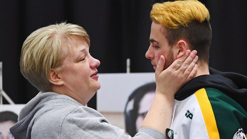 <p>               FILE - In this Sunday, April 8, 2018, file photo, Humboldt Broncos' Nick Shumlanski, who was released from the hospital earlier in the day, is comforted by a mourner during a vigil at the Elgar Petersen Arena, home of the Humboldt Broncos, to honor the victims of a fatal bus accident, in Humboldt, Saskatchewan. Shumlanski sustained a fractured bone behind his ear and a lumbar avulsion fracture, but walked away from the crash. He has been told his ear may never heal but he doesn't expect that will have a significant effect. His back seems to have healed, but he continues to deal with emotional issues. Shumlanski is playing hockey for the University of Prince Edward Island Panthers in Charlottetown. (Jonathan Hayward/The Canadian Press via AP, File)             </p>