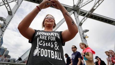 <p>               Denver Broncos fan Trina Henderson takes photos on the final day of the NFL football draft Saturday, April 27, 2019, in Nashville, Tenn. (AP Photo/Mark Humphrey)             </p>