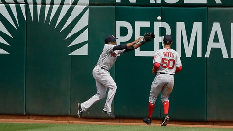 <p>               Boston Red Sox center fielder Jackie Bradley Jr., left, and right fielder Mookie Betts chase after a ball hit by the Oakland Athletics' Stephen Piscotty in the fourth inning of a baseball game Thursday, April 4, 2019, in Oakland, Calif. Piscotty hit a ground rule double and two runs scored on the play. (AP Photo/Eric Risberg)             </p>