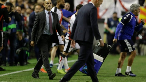 <p>               Rayo Vallecano's coach Paco Jemez, left, looks over to Real Madrid's coach Zinedine Zidane as he walks off the pitch at the end of a Spanish La Liga soccer match between Rayo Vallecano and Real Madrid at the Vallecas stadium in Madrid, Spain, Sunday, April 28, 2019. Rayo won the match 1-0. (AP Photo/Paul White)             </p>