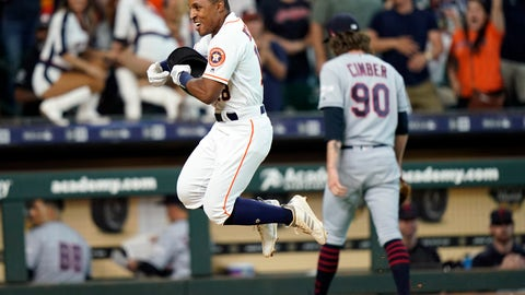 <p>               Houston Astros' Tony Kemp, left, celebrates after hitting the game-winning home run as Cleveland Indians relief pitcher Adam Cimber (90) walks to the dugout during the 10th inning of a baseball game Saturday, April 27, 2019, in Houston. The Astros won 4-3. (AP Photo/David J. Phillip)             </p>