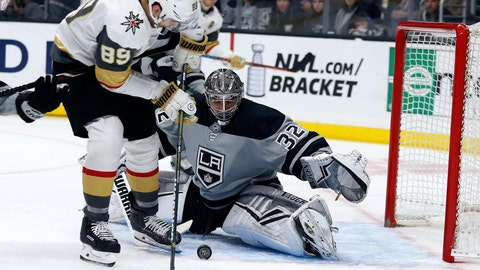 <p>               Los Angeles Kings goalie Jonathan Quick (32) stops a shot by Vegas Golden Knights forward Alex Tuch (89) during the first period of an NHL hockey game Saturday, April 6, 2019, in Los Angeles. (AP Photo/Ringo H.W. Chiu)             </p>