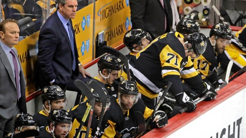 <p>               Pittsburgh Penguins coach Mike Sullivan, rear second from left, and assistant Sergei Gonchar, left, stand behind their bench as Evgeni Malkin (71) waits to take the ice, during the third period in Game 4 of an NHL hockey first-round playoff series against the New York Islanders in Pittsburgh, Tuesday, April 16, 2019. The Islanders won 3-1, sweeping the series. (AP Photo/Gene J. Puskar)             </p>