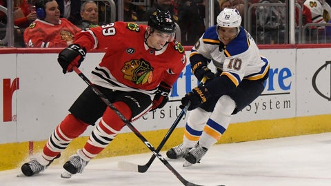 <p>               Chicago Blackhawks defenseman Dennis Gilbert (39) is defended by St. Louis Blues center Brayden Schenn (10) during the second period of an NHL hockey game Wednesday, April 3, 2019, in Chicago. (AP Photo/David Banks)             </p>