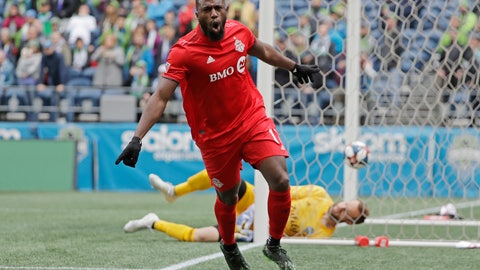 <p>               Toronto FC forward Jozy Altidore celebrates after he scored a goal against Seattle Sounders goalkeeper Stefan Frei, right, during the first half of an MLS soccer match, Saturday, April 13, 2019, in Seattle. (AP Photo/Ted S. Warren)             </p>