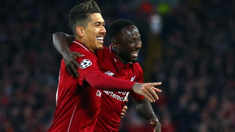 <p>               Liverpool's Naby Keita celebrates with Roberto Firmino, left, after scoring the opening goal during the Champions League quarterfinal, first leg, soccer match between Liverpool and FC Porto at Anfield Stadium, Liverpool, England, Tuesday April 9, 2019. (AP Photo/Dave Thompson)             </p>