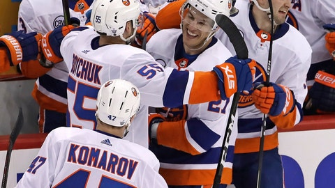 <p>               New York Islanders' Anders Lee (27) is mobbed by teammates after getting an empty-net goal during the third period in Game 3 of an NHL first-round hockey playoff series against the Pittsburgh Penguins in Pittsburgh, Sunday, April 14, 2019. The Islanders won 4-1. (AP Photo/Gene J. Puskar)             </p>