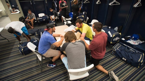 "<p>               FILE - In this April 8, 2015, file photo, members of the Biloxi Shuckers minor league baseball team eat lunch before practice at the Pensacola Blue Wahoos' stadium in Pensacola, Fla. Minor leaguers at the lowest levels can make as little as $1,100 per month despite spending 50-to-70 hours per week at the ballpark. A lawsuit alleging MLB violated minimum wage and overtime requirements was pre-empted in 2018 when Congress passed the ""Save America's Pastime Act,"" which stripped minor leaguers of the protection of federal minimum wage laws. (AP Photo/Michael Spooneybarger, File)             </p>"