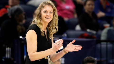 <p>               Missouri State head coach Kellie Harper smiles as he directs her team during the second half of a regional semifinal game against the Stanford in the NCAA women's college basketball tournament, Saturday, March 30, 2019, in Chicago. (AP Photo/Nam Y. Huh)             </p>