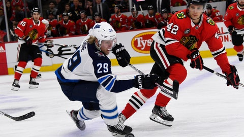 <p>               Winnipeg Jets right wing Patrik Laine (29) and Chicago Blackhawks defenseman Gustav Forsling (42) fight for the puck during the first period of an NHL hockey game Monday, April 1, 2019, in Chicago. (AP Photo/Matt Marton)             </p>