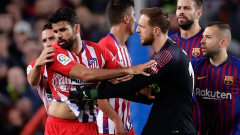 <p>               Atletico goalkeeper Jan Oblak, center right, tries to calm down teammate Diego Costa, left, after he was sent off with a red card for insulting referee Jesus Gil Manzano during a Spanish La Liga soccer match between FC Barcelona and Atletico Madrid at the Camp Nou stadium in Barcelona, Spain, Saturday April 6, 2019. (AP Photo/Manu Fernandez)             </p>