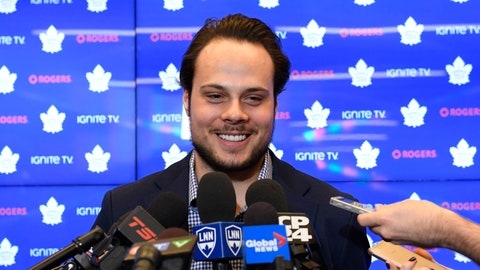 """<p>               FILE - In this Tuesday, Feb. 5, 2019 file photo, Toronto Maple Leafs center Auston Matthews smiles at a press conference in Toronto. Auston Matthews could soon wear the """"C"""" as the long-term captain in Toronto. But he also got razzed by his Maple Leafs teammates for doing a stylish GQ fashion photo shoot.  (Nathan Denette/The Canadian Press via AP, File)             </p>"""