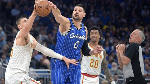 <p>               Orlando Magic center Nikola Vucevic (9) wins a jump ball with Atlanta Hawks center Alex Len, left, as forward John Collins (20) and official Jason Phillips, right, watch during the first half of an NBA basketball game Friday, April 5, 2019, in Orlando, Fla. (AP Photo/Phelan M. Ebenhack)             </p>