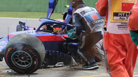 <p>               CORRECTS THE NAME OF DRIVER - Toro Rosso driver Alexander Albon of Thailand waits for help to get out of his crashed car during the third practice session for the Chinese Formula One Grand Prix at the Shanghai International Circuit in Shanghai on Saturday, April 13, 2019. (AP Photo/Ng Han Guan)             </p>