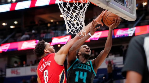 <p>               Charlotte Hornets forward Michael Kidd-Gilchrist (14) goes to the basket against New Orleans Pelicans center Jahlil Okafor (8) in the first half of an NBA basketball game in New Orleans, Wednesday, April 3, 2019. (AP Photo/Gerald Herbert)             </p>
