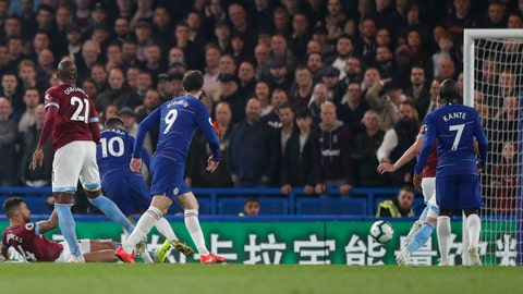 <p>               Chelsea's Eden Hazard, third left, scores his sides first goal during the English Premier League soccer match between Chelsea and West Ham at Stamford Bridge stadium in London, Monday, April 8, 2019. (AP Photo/Alastair Grant)             </p>