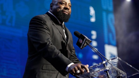 <p>               Former Dallas Cowboys player Ed Jones announces the Cowboys pick as Central Florida defensive tackle Trysten Hill during the second round of the NFL football draft, Friday, April 26, 2019, in Nashville, Tenn. (AP Photo/Mark Humphrey)             </p>