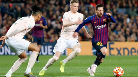 <p>               Barcelona forward Lionel Messi, right, runs with the ball past Manchester United's Scott McTominay, center, and Manchester United's Chris Smalling during the Champions League quarterfinal, second leg, soccer match between FC Barcelona and Manchester United at the Camp Nou stadium in Barcelona, Spain, Tuesday, April 16, 2019. (AP Photo/Joan Monfort)             </p>