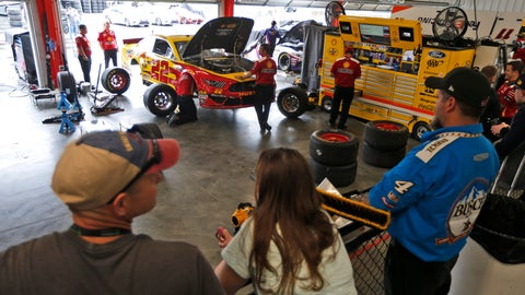 <p>               Fans watch the team of Joey Logano as they work on the car in the garage at Richmond International Raceway in Richmond, Va., Friday, April 12, 2019. (AP Photo/Steve Helber)             </p>
