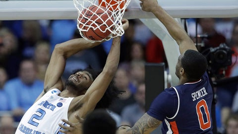 <p>               North Carolina's Coby White (2) dunks as Auburn's Horace Spencer (0) defends during the second half of a men's NCAA tournament college basketball Midwest Regional semifinal game Friday, March 29, 2019, in Kansas City, Mo. (AP Photo/Charlie Riedel)             </p>