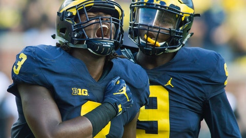 <p>               FILE - In this Sept. 17, 2016, file photo, Michigan defensive end Rashan Gary (3) celebrates a sack alongside linebacker Mike McCray (9) in the first half of an NCAA college football game against Colorado, in Ann Arbor, Mich. Gary is a possible pick in the 2019 NFL Draft. (AP Photo/Tony Ding, File)             </p>