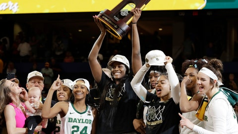 <p>               Baylor center Kalani Brown holds the championship trophy next to guard Chloe Jackson (24) after Baylor defeated Notre Dame 82-81 in the final of the NCAA women's college basketball tournament Sunday, April 7, 2019, in Tampa, Fla. (AP Photo/Chris O'Meara)             </p>