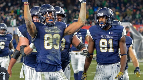 <p>               FILE - In this Nov. 17, 2018, file photo, Notre Dame wide receiver Chase Claypool (83) celebrates a touchdown during an NCAA college football game against Syracuse, at Yankee Stadium in New York. The Irish didn't need to look far to replace tall (6-foot-4½) boundary wide receiver Miles Boykin, who led the Irish in receptions with 59 receptions. They just moved 6-foot-4 starter Chase Claypool there after he caught 50 passes his junior season, one more than returning senior slot receiver Chris Finke. (AP Photo/Howard Simmons, File)             </p>